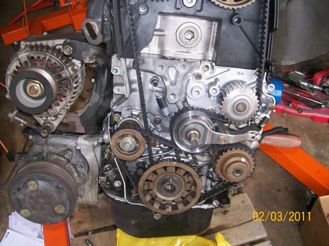 oil pump and manual tensioner