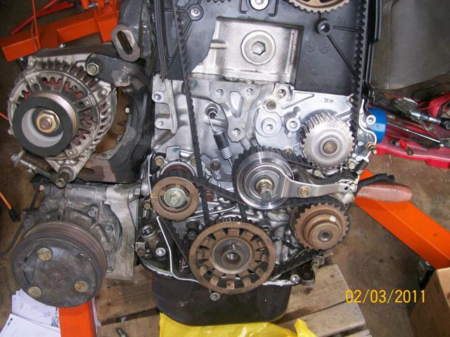 oil pump and manual tensioner